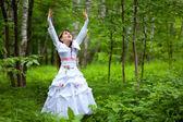 Girl raises her hands up — Stock Photo