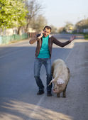 Man with dirty pig — Stockfoto
