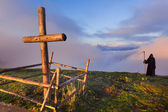 Catholic cross on a mountaintop and death — Stock Photo