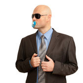 Funny bald man in suit with soother — Stock Photo