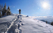 Girl hiking in the mountains at winter — Stock Photo