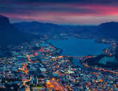 Night view of the city Lecco  and Lake Garlate. — Stock Photo