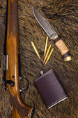Rifle, cartridges, knife and flask — Stock Photo