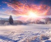 Winter sunrise in mountain village. — Stockfoto