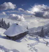 Hut covered with snow in the mountains — Stock Photo