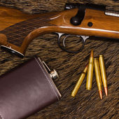 Rifle, bullets and flask — Stockfoto