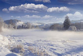 Winter landscape in the mountain village. — Stock Photo
