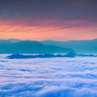 Sunrise over the sea of fog in the mountains — Stock Photo #50890343