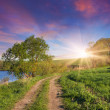 Sunrise with road near the lake — Stock Photo #50890947