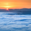 Sunrise over the sea of fog in the mountains — Stock Photo #50892037
