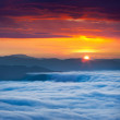 Sunrise over the sea of fog in the mountains — Stock Photo #50894437