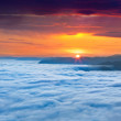 Sunrise over the sea of fog in mountains — Stock Photo #50894787