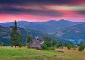 Summer sunset in the mountain village. — Stock Photo