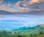 Mountain village in the mist — Stock Photo