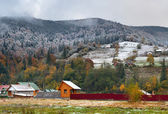 First snow in mountains village — Stockfoto