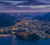 Night view of the city Valmadrera and lake Annone — Stock Photo