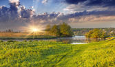 Spectacular sunrise over misty river — Stock Photo