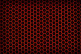 Red perforated plastic background — Foto Stock