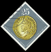 DDR stamp with golden coin — Stock Photo