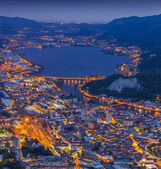 Night view of the city Lecco and Lake Garlate — Stock Photo