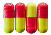 Four medical capsules — Stock Photo