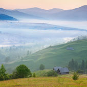 Misty morning in the Carpathian mountains village. Sunrise — Stock Photo