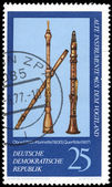 DDR stamp shows a wind musical instruments — Stock Photo