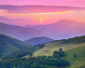 Sunset in the mountains at the summer — Stock Photo