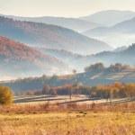 Autumn panorama of the mountain village — Stock Photo #50977185