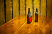 Two bottle on the wooden table — Stock Photo
