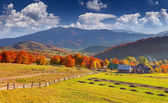 Autumn landscape in the mountain village — Stock Photo