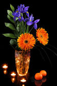 Flowers with mandarins and candles — Stockfoto