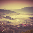 Misty morning in the mountain village. — Stock Photo #51267171