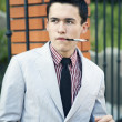 Men's fashion, man, smoking, jacket, smoke, cigarette, mouthpiece, youth, people, young — Stock Photo #51061851