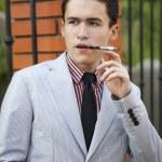 Men's fashion, mens, man, smoking, jacket, smoke, cigarette, mouthpiece, youth, people — Stock Photo #51061869