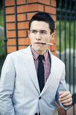 Men's fashion, man, smoking, jacket, smoke, cigarette, mouthpiece, youth, people, young — Stock Photo