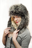 Young women in fur hat — Stock Photo