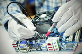 Fixing mother board — Stock Photo