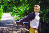 Portrait of attractive man in trendy casual clothing and glasses — Stock Photo