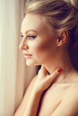 Emotive portrait of young beautiful woman with long blonde hair. — Stock Photo