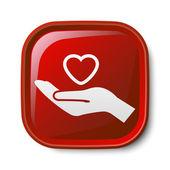Heart in hand icon — Stockvector