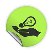 Light bulb in hand — Stock Vector