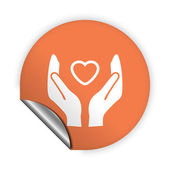 Heart in hand icon — Stock Vector