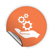 Gear in hand icon — Stock Vector