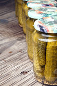 Jars of preserved gherkins — Stock Photo