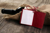 Bottle of red wine with a message — Stock Photo