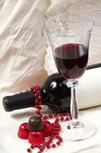Chocolate with wine bottle and glasses — Stock Photo