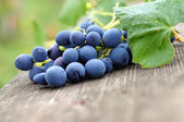 Grapes on wooden table. — Stock Photo