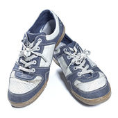 Old worn out sneakers — Stock Photo