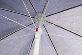 Grey sunblock umbrella — Stock Photo